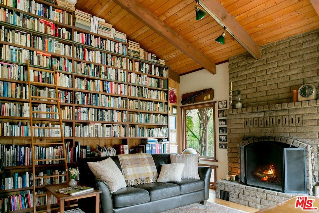 Floor to ceiling book shelves