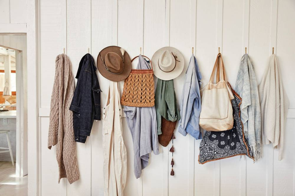 hats and coats on hooks entry