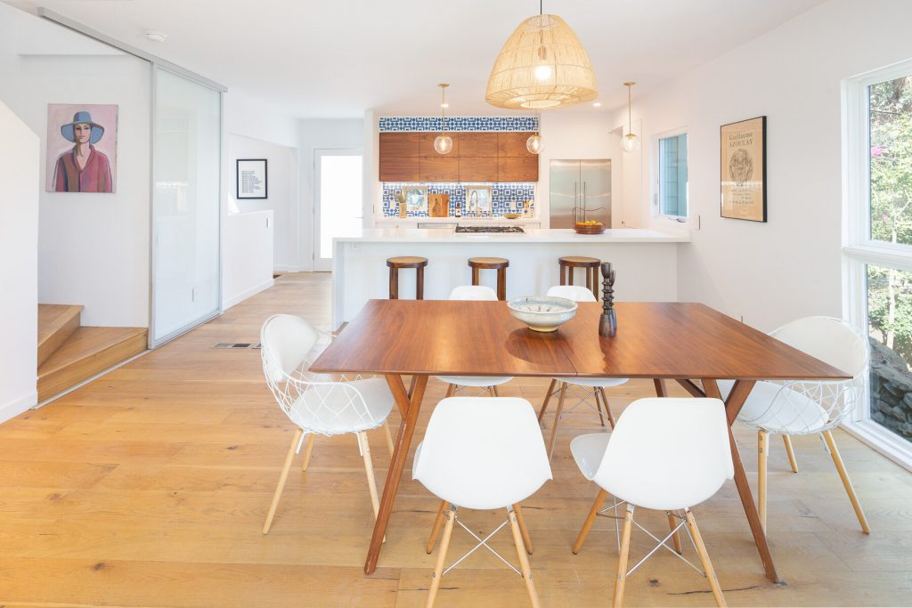 modern dining room open kitchen wood floors and blue tile