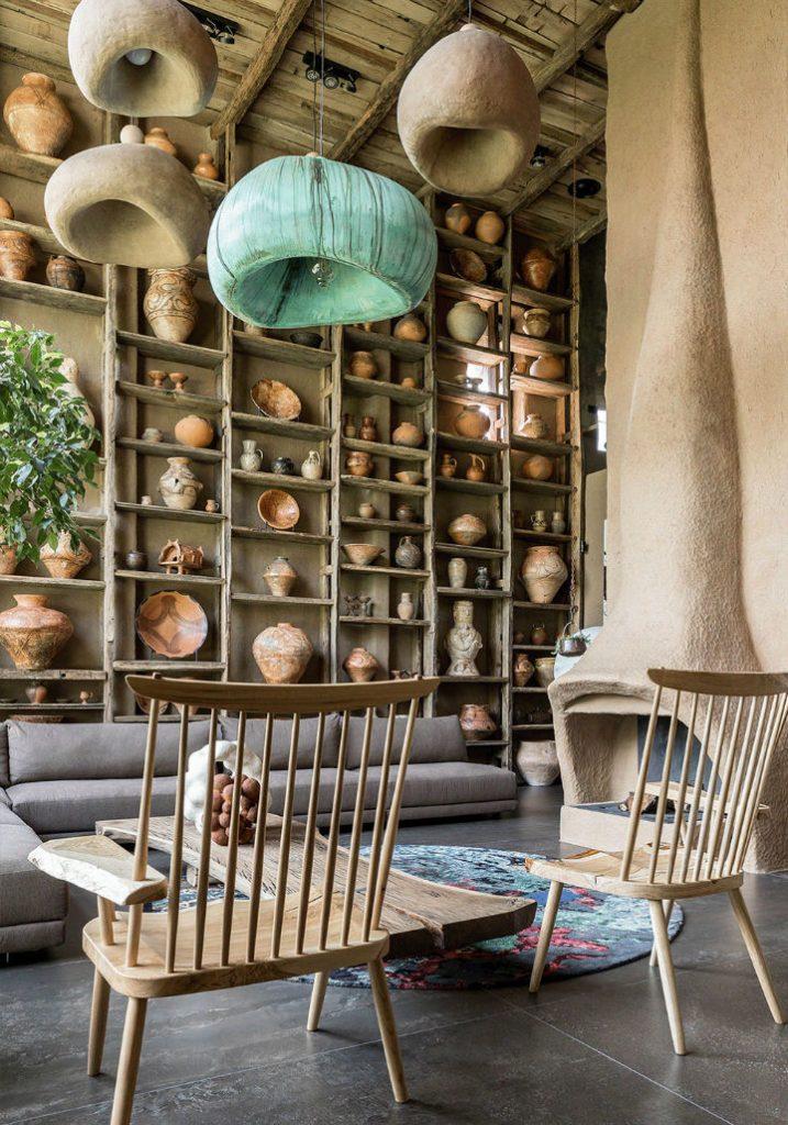 rustic chic living room ceramics floor to ceiling shelves