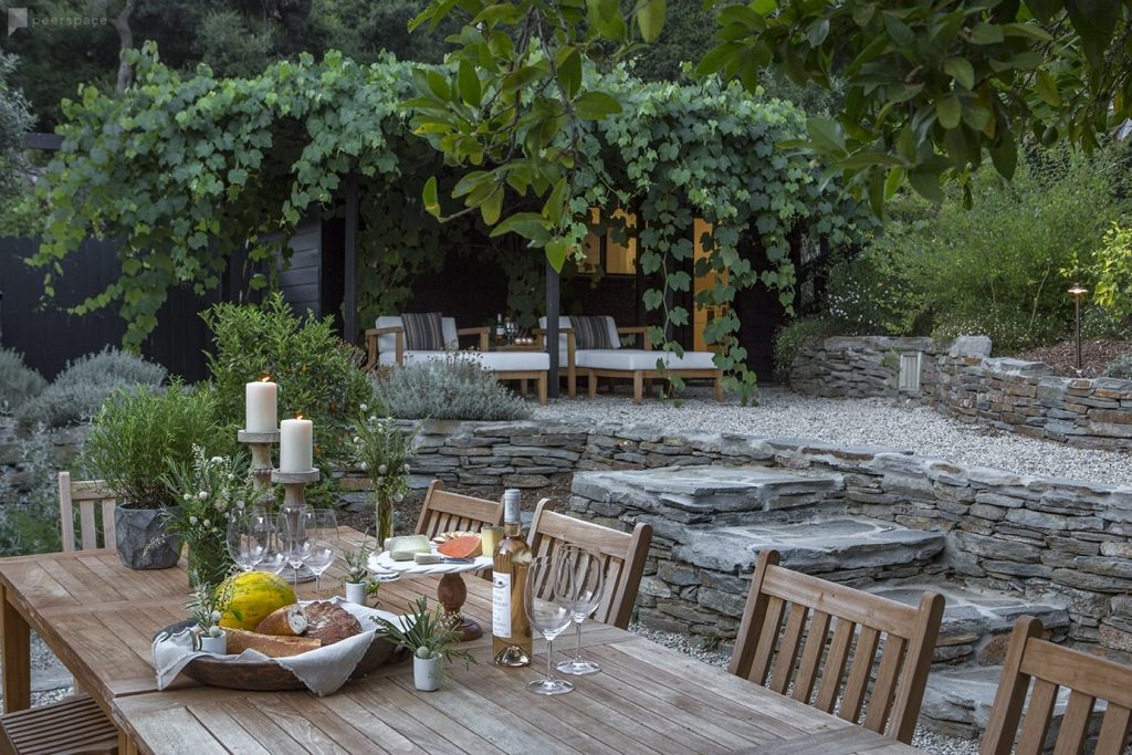 outdoor dining in Topanga Canyon stone patio walls and vine covered trellis