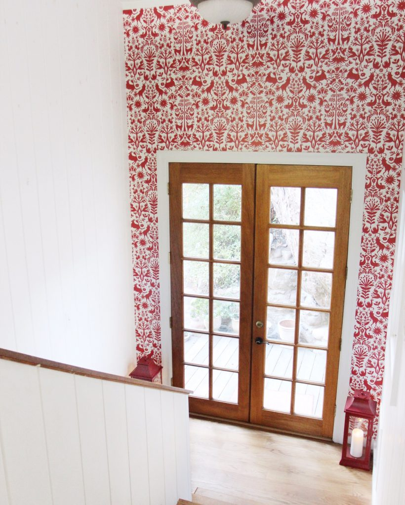 red wallpaper french doors stairwell
