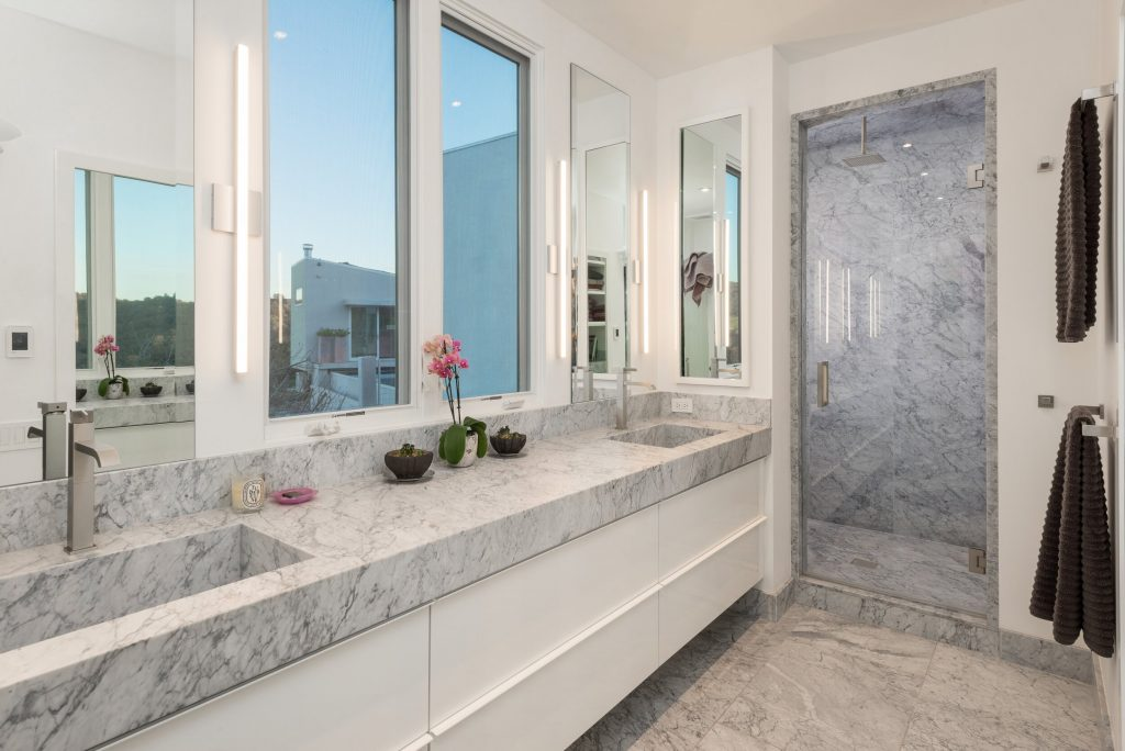 master bathroom with marble walk in shower