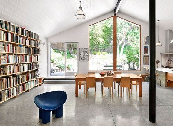 open dining area with book shelves modern big window