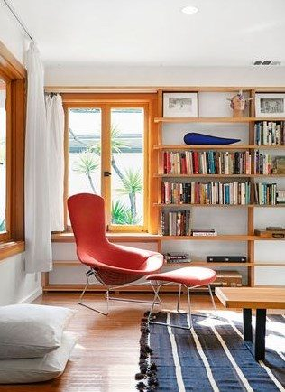 modern chair salmon book shelves