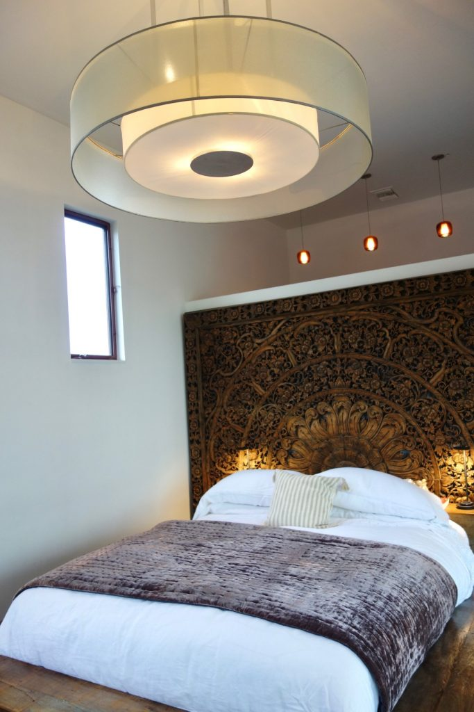 master bedroom with circle light fixture