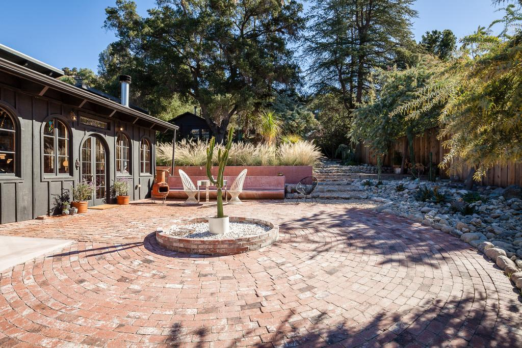 Brick garden flooring dry climate garden  natural grasses and indigenous tree's