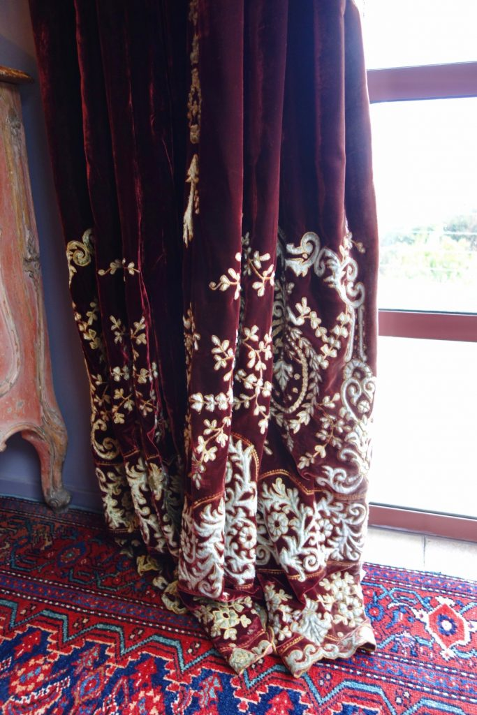 close up of embroidered curtain red velvet
