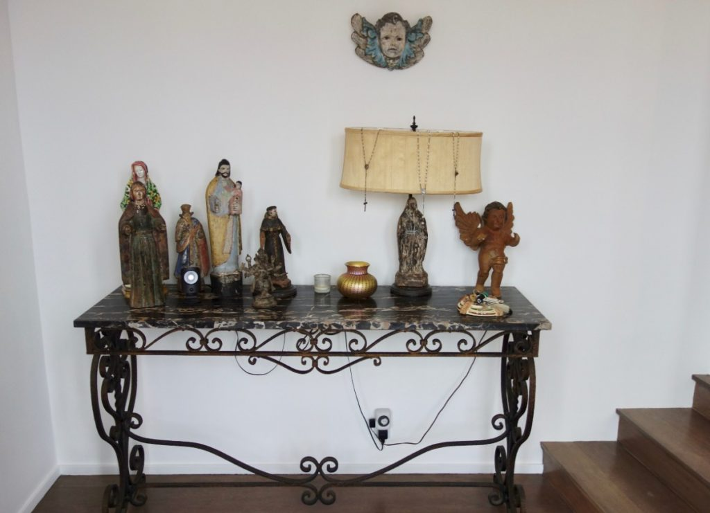 entry table with sculptures