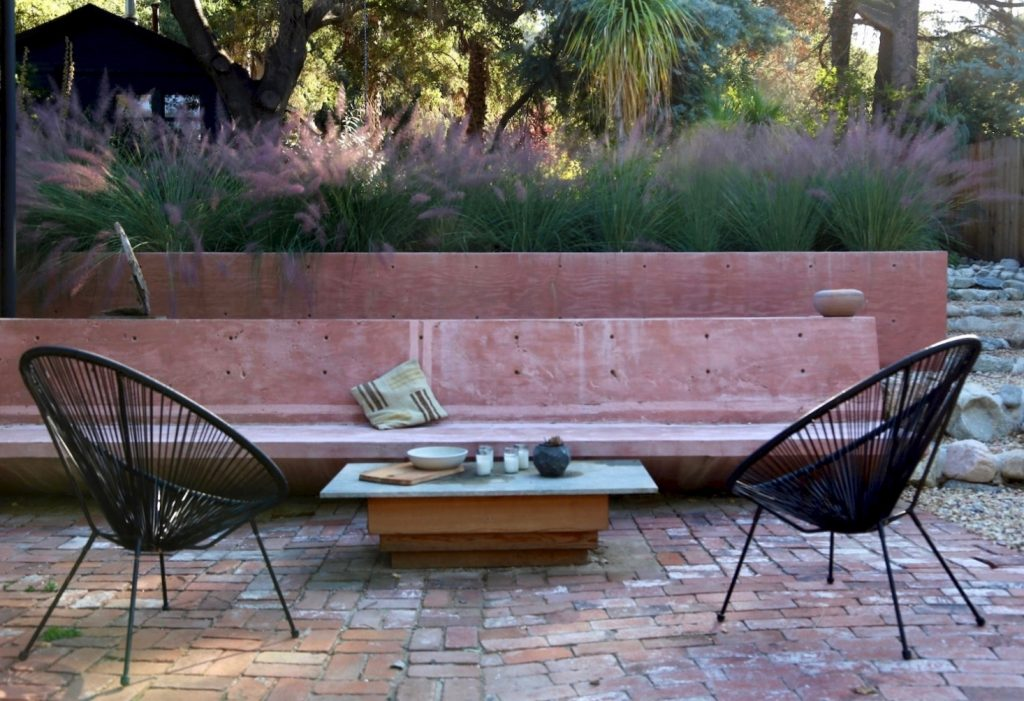 pink bench cement seat and black modern chairs