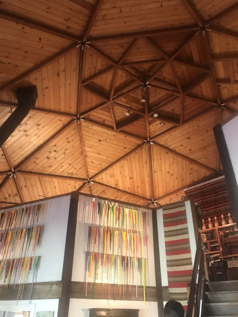 wood geometric ceiling in dome house