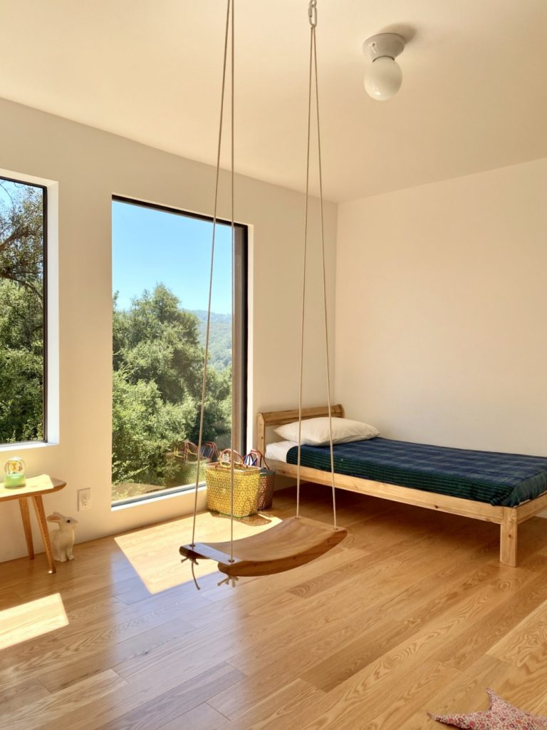 modern kids bedroom with swing